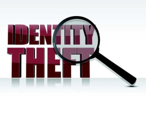 words identity theft and magnifying glass