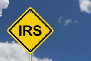 yield sign with IRS on it