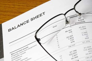 photo of balance sheet & glasses