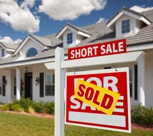 house with short sale sold sign