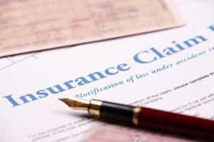 insurance claim form photo with pen