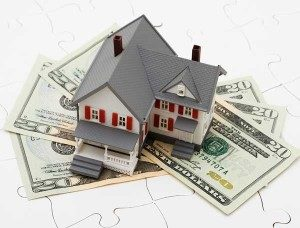 model house with money unde it