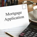 mortgage application envelope near keyboard