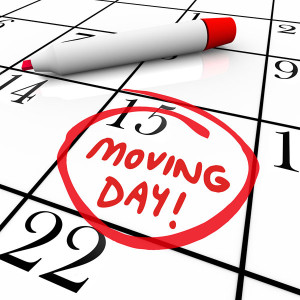 The words Moving Day and a date circled on a calendar with a red