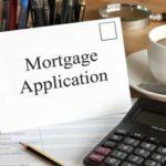 mortgage application envelope near keyboard
