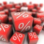 multiple red dice with percentage signs