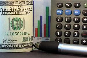 photo roll of money, calculator & pen