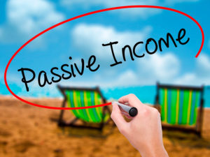 Man Hand writing Passive Income with black marker on visual screen. Isolated on nature. Business technology internet concept. Stock Photo