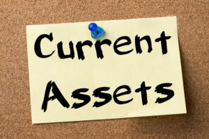 Current Assets - adhesive label pinned on bulletin board - horizontal image